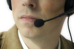 Homme avec l'écouteur Image stock