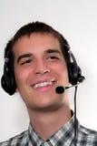 Homme avec l'écouteur Photographie stock
