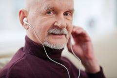 Homme avec l'écouteur Photo libre de droits