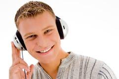 Homme avec l'écouteur vous regardant Photographie stock libre de droits