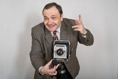 Homme avec l'appareil-photo Photos stock