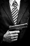 Homme avec l'arme Photos stock