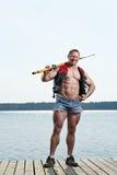 Homme avec l'aviron Photo stock