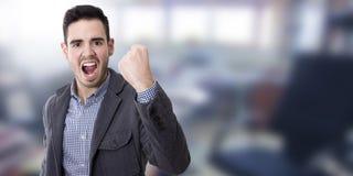 Homme avec l'expression du succès image stock