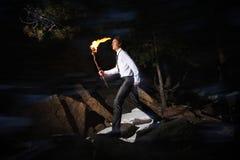 Homme avec l'incendie Photos stock
