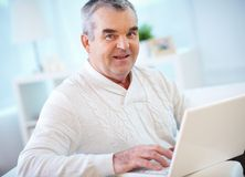 Homme avec l'ordinateur portable Photos libres de droits