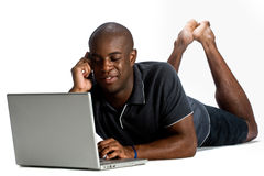 Homme avec l'ordinateur portatif photographie stock