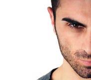 Homme avec la barbe, demi visage Photos libres de droits