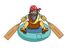Homme avec la barbe sur un canot en caoutchouc Photos stock