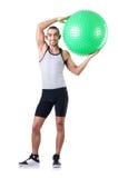 Homme avec la boule suisse faisant des exercices Images stock