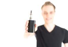 Homme avec la cigarette électronique Photo stock
