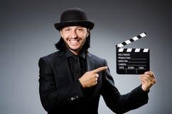 Homme avec la claquette de film Photo stock