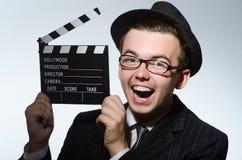 Homme avec la claquette de film Photographie stock libre de droits