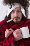 Homme avec la grippe et la fièvre Images stock
