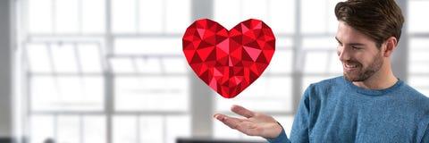 homme avec la main et le coeur ouverts par la fenêtre de bureau Photo libre de droits