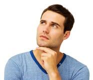 Homme avec la main sur Chin Looking Up Images libres de droits