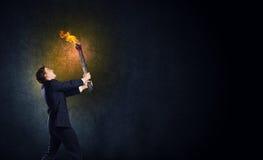 Homme avec la torche Image stock