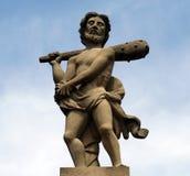 Homme avec le bâton. Image stock