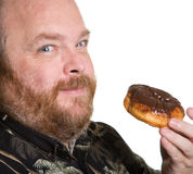 Homme avec le beignet de chocolat Photographie stock libre de droits