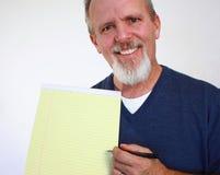 Homme avec le bloc-notes Image libre de droits