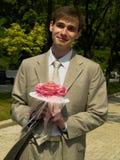 Homme avec le bouquet Photographie stock libre de droits
