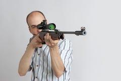 Homme avec le canon Image stock
