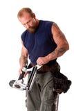 Homme avec le canon de clou Image stock