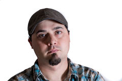 Homme avec le chapeau de conducteur et la chemise de plaid Photographie stock