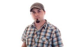 Homme avec le chapeau de conducteur et la chemise de plaid Images stock