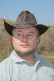 Homme avec le chapeau de cowboy Photographie stock libre de droits