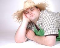 Homme avec le chapeau de paille Photographie stock libre de droits