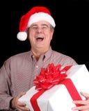 Homme avec le chapeau de Santa retenant un présent Images stock