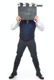 Homme avec le clapperboard Photographie stock libre de droits