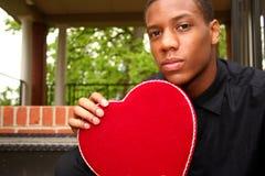 Homme avec le coeur Images stock
