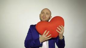 Homme avec le coeur banque de vidéos