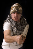 Homme avec le couteau Image stock