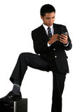 Homme avec le dispositif mobile Photos stock