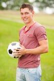 Homme avec le football photographie stock libre de droits
