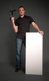 Homme avec le foret et panneau Photographie stock libre de droits