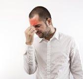 Homme avec le mal de tête Photos libres de droits