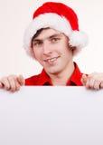 Homme avec le panneau vide vide de bannière Noël Photos libres de droits