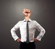 Homme avec le poing au lieu de la tête Photographie stock libre de droits