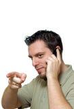Homme avec le pointage de téléphone Photographie stock libre de droits