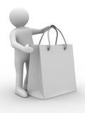 Homme avec le sac shoping sur le blanc Photos stock
