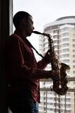Homme avec le saxophone Image libre de droits