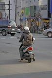 Homme avec le scooter Image libre de droits