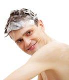 Homme avec le shampooing au-dessus du cheveu dans le bain Photos libres de droits