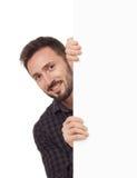 Homme avec le signe blanc Photo stock