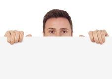 Homme avec le signe blanc Photographie stock