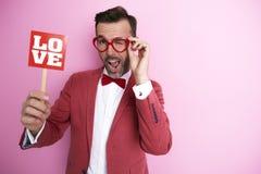 Homme avec le signe d'amour Photos stock